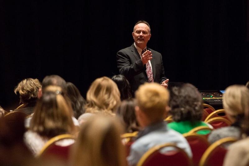 tom viola speaking at a dental conference
