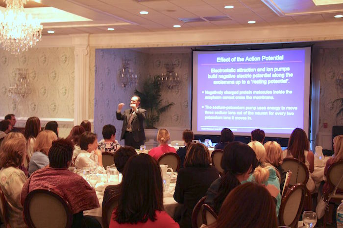 tom viola speaking at a dental seminar